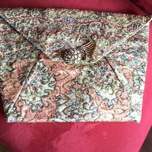 Vintage clutch embroidered with metal thread.